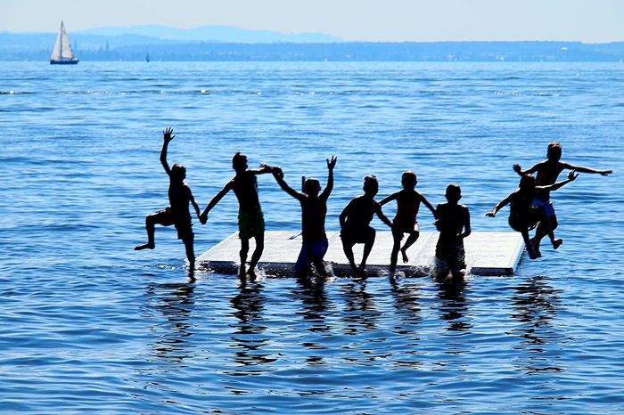 Sea Water Waterfront Men Enjoyment Real People Lifestyles Leisure Activity Women Nature Beauty In Nature Outdoors Summer Children Friendship Day Togetherness Sky