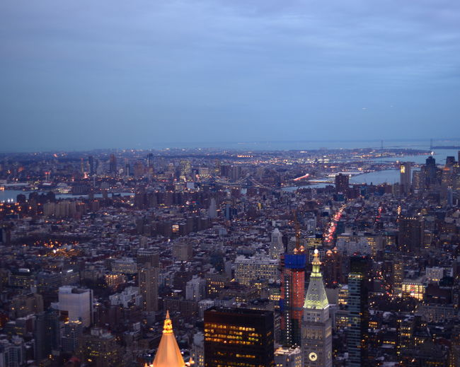 High angle view of illuminated buildings and river at manhattan