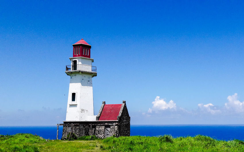 Lighthouse in South Batan, Batanes! Batanes, Philippines Batanes Islands Batanes2018 Lighthousephotography Lighthouse_captures Lighthouse Tower EyeEm Selects Clear Sky Lighthouse Water Blue Beach Red Flag Sea Summer Tower Tall - High Lookout Tower Tranquil Scene Countryside