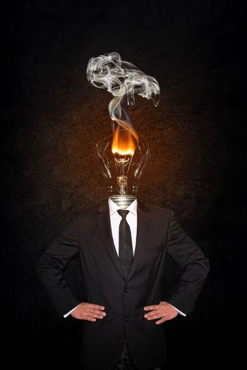 Reflection of man on illuminated lighting equipment