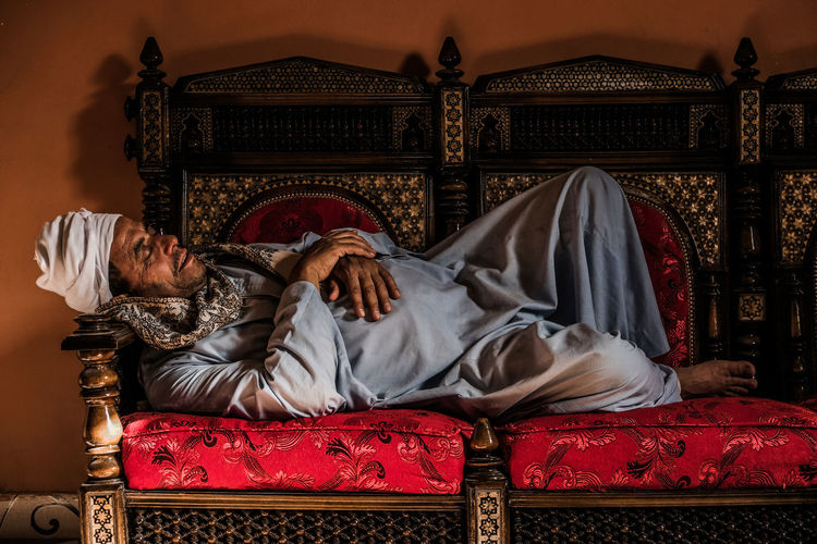 The Photojournalist - 2018 EyeEm Awards The Portraitist - 2018 EyeEm Awards The Still Life Photographer - 2018 EyeEm Awards The Traveler - 2018 EyeEm Awards Adult Clothing Eyes Closed  Furniture Indoors  Lifestyles Luxury Lying Down Lying On Side Males  Mature Adult Mature Men Men One Person Real People Relaxation Sitting Sleeping Sofa Wealth