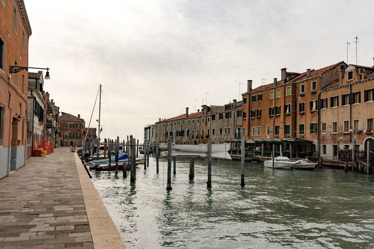 Giudecca Water Architecture Building Exterior Built Structure Canal Transportation Nautical Vessel City Mode Of Transportation Nature Waterfront Sky Building Day Incidental People Travel Destinations Travel Residential District Cloud - Sky Outdoors Venice, Italy Giudecca Island