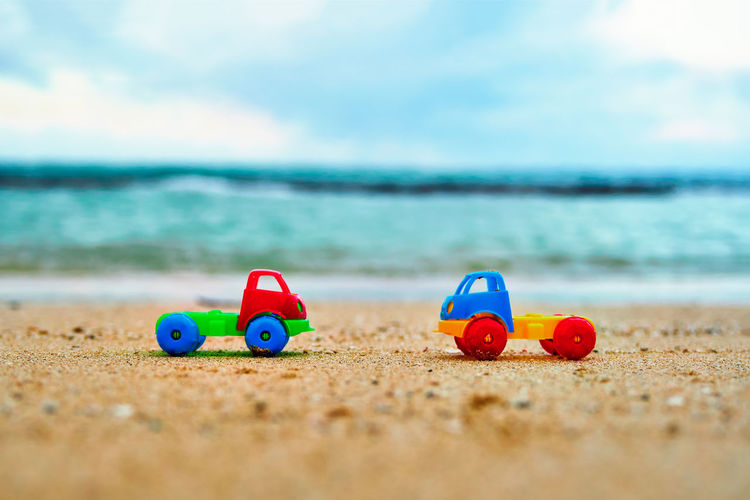 Surface Level View Of Toy Cars At Beach