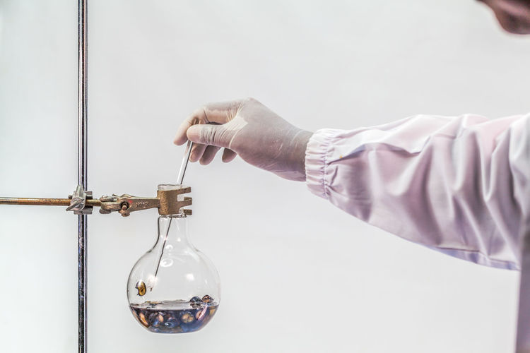 Cropped Hand Of Scientist Analyzing Chemical In Laboratory