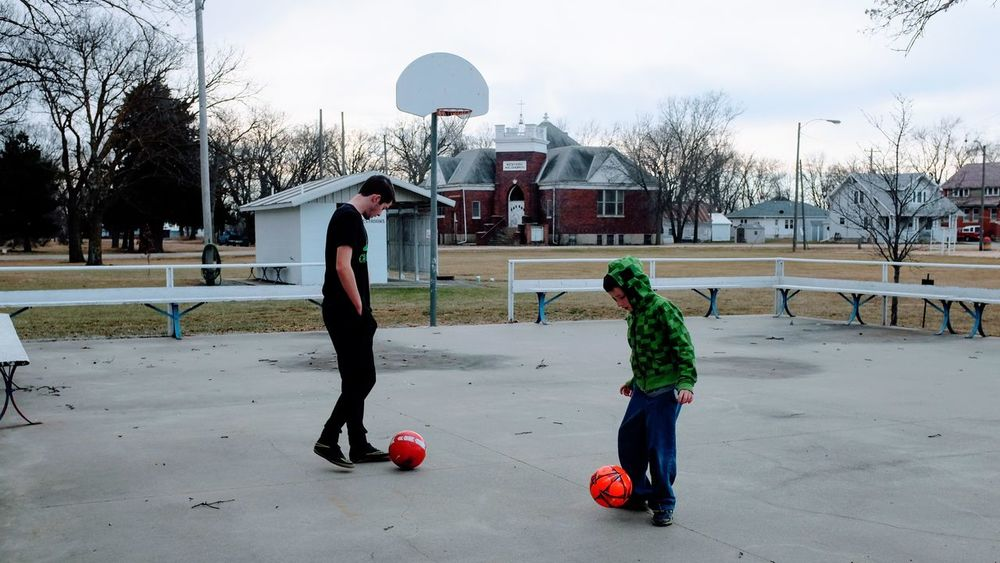 December 2016, Western, Nebraska A Day In The Life Bonding Brothers Camera Work Childhood Everyday Lives Family Time Football Full Length Growing Up Kickin It Mimic Outdoors Photo Diary Rural America Small Town Stories Soccer Soccerball Sports Training Storytelling Together Togetherness Two People Visual Journal Wintertime