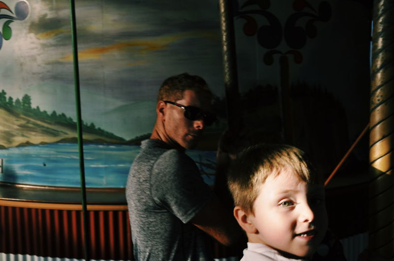 Fatherhood Moments Father & Son Enjoying Life Merry Go Round Carousel Boardwalk Fathers Dad And Me Rides Shadows Golden Hour Autism Kids At Play Candid Portraits