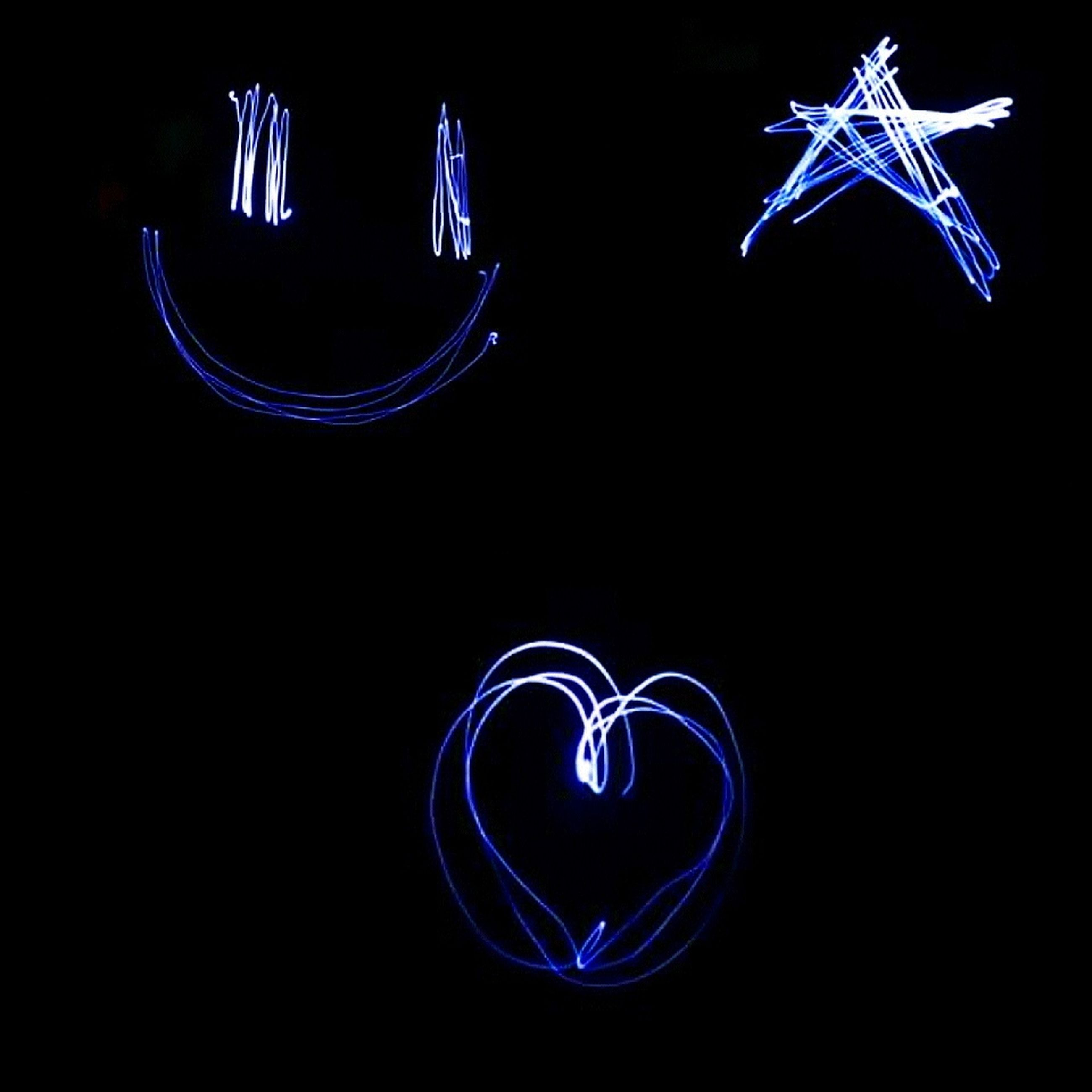 illuminated, night, studio shot, black background, glowing, long exposure, light painting, blue, copy space, motion, lighting equipment, abstract, light trail, pattern, creativity, low angle view, art, light - natural phenomenon, multi colored, art and craft