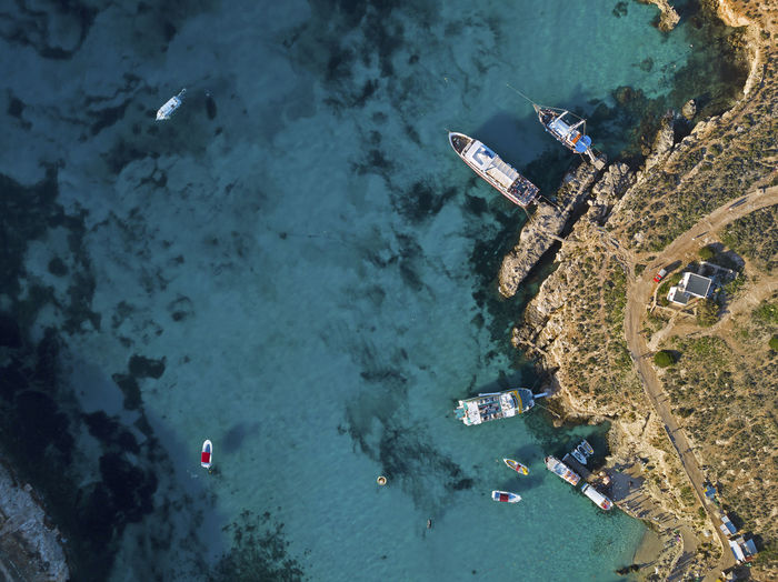 Aerial View Of Boats Moored At Beach