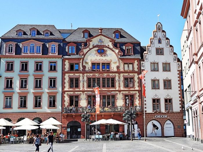 Ornamented buildings on Market Place in Mainz, Germany Architecture Built Structure Building Exterior Sky Building City Clear Sky Incidental People Window History The Past Street Façade Outdoors