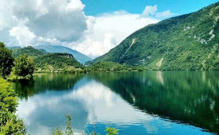 Water Tranquil Scene Reflection Scenics Tranquility Mountain Lake Sky Cloud - Sky Majestic Beauty In Nature Idyllic Lago Del Corlo Lago Di Arsiè Veneto Italy Symmetry Water Reflections Non-urban Scene Cloud Countryside Mountain Range Travel Destinations Waterfront Calm