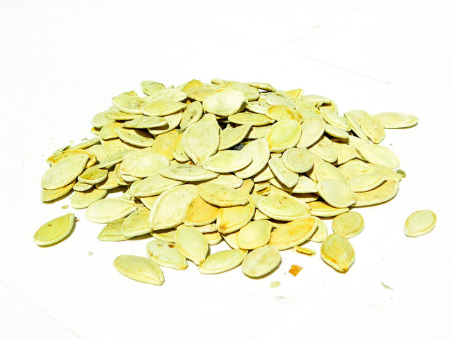 Pumpkin seeds EyeEmNewHere Seed Close-up Food Food And Drink Freshness Healthy Eating Homemade Bread Indoors  Large Group Of Objects No People Pumkin Pumpkin Seeds Simple Small Objects Studio Shot White Background
