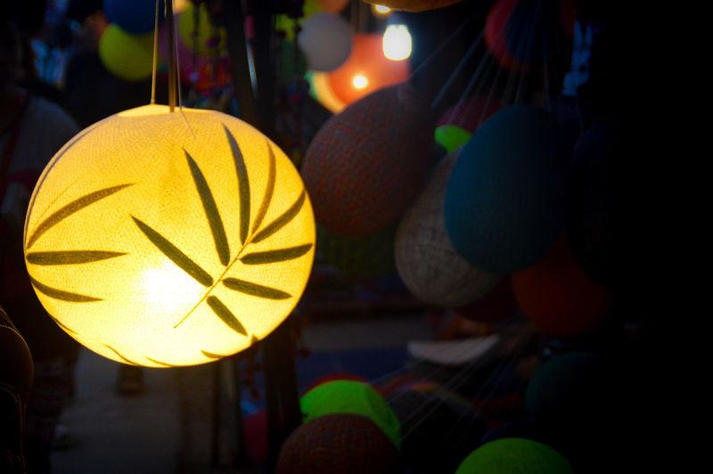 Close-up of illuminated lantern hanging at market stall