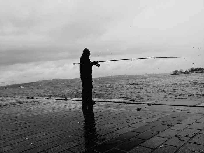 Fisherman One Person Outdoors Silhouette Standing Sky Adults Only People Adult Water Beauty In Nature Day