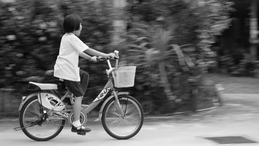 Funny Excited Black And White Child Blurry Background Nature Paying Kick Day Time Lifestyles Relaxing Exercise Quickly Speed Fast Road Bicycle Cycling Basket One Person Bicycle Basket Full Length Outdoors Day