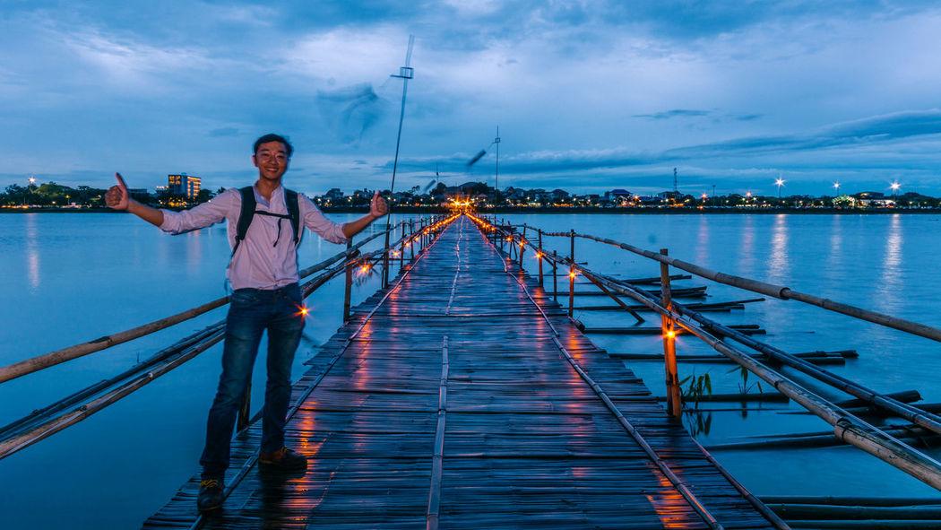 PHAYAO, THAILAND - JULY 19, 2016: The bamboo bridge, The bamboo bridge of Wat Ti Lok Aram temple in kwan phayao off freshwater lake of Thailand. Day is the important Buddhist. ASIA Bamboo Bridge Beautiful Bridge Candle Lit Floating Footbridge Important Buddhist Kwan Phayao Lake Landmark Landscape Light Mountain Natural Northern Outdoors River Sky Thailand Tourism Travel Twilight Walkways  WatTiLokAram