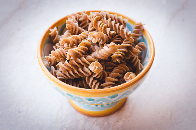 Raw fusilli pasta made with timilia, sicilian ancient grain, in a decorated ceramic bowl Copy Space Fusilli Sicily Background Bowl Ceramics Close-up Decoration Food Food And Drink Healthy Eating Sicilian Sicilian Food Uncooked