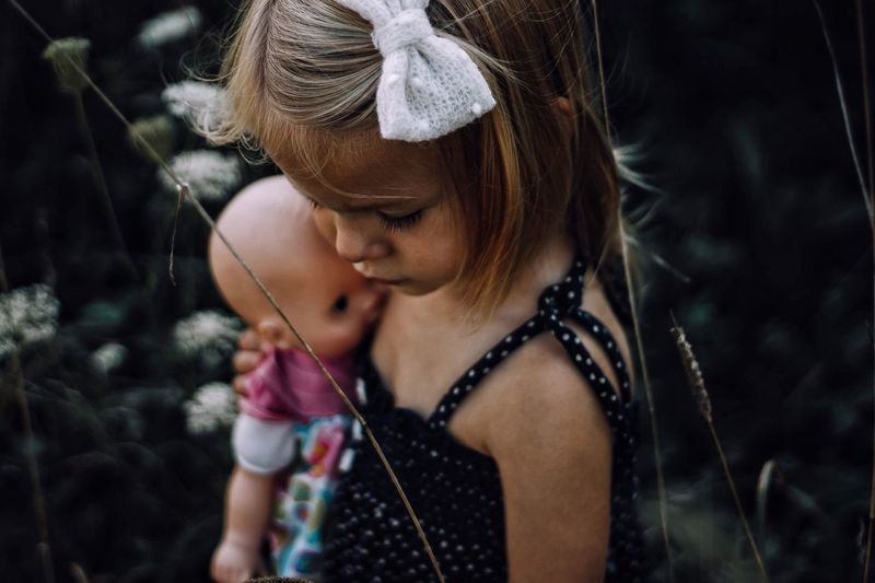 Doll. Childhood One Person Girls Holding Leisure Activity Outdoors Blond Hair Real People Looking Down Focus On Foreground Elementary Age Casual Clothing Lifestyles Standing Day Water Close-up People doll little girl First Eyeem Photo