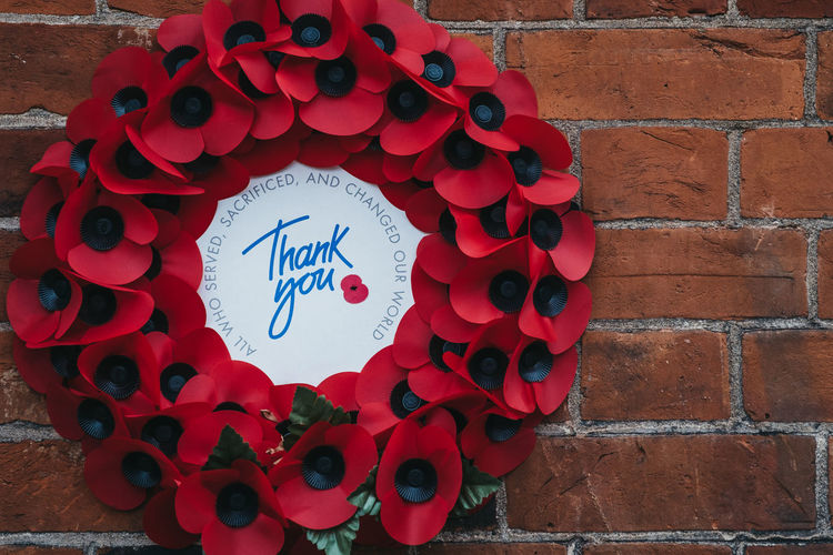 Remembrance poppy wreath with a Thank You message inside on a brick wall in London, UK. Poppy Flowers Red Day Thank You London Veterans Decoration Concept Military Uk Remembrance Emotion England Message Poppy Commemorate Brick Wall Wreath Close-up Campaign Lest We Forget No People Remembrance Day Remembrance Poppy Armistice Day