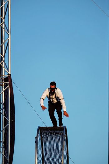 Nebraska State Fair August 2016 Grand Island, Nebraska -- Flippin' - A Steam Punk Theme Aerial & Acrobatic Spectactular Acrobatics  Action Shot  Balancing Act Blindfolded Camera Work Carnival Check This Out Circus Clear Sky Costume Danger Daredevil Day EyeEm Gallery Low Angle View Nebraska Outdoors Performing Arts Photography Photojournalism Standing State Fair Steam Punk Stunt Show Stunts