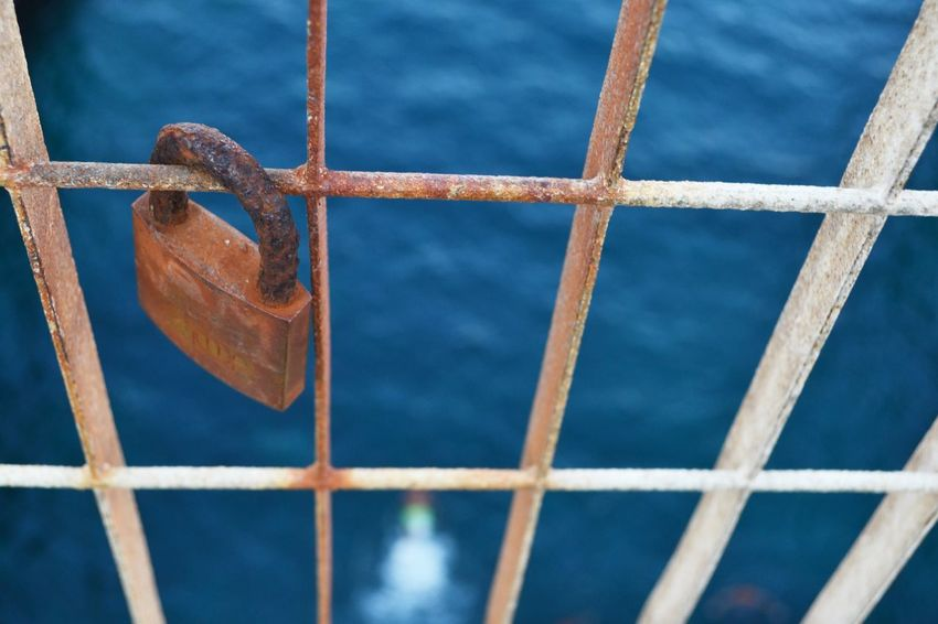 Acciaio Barbed Wire Blue Catenaccio Chainlink Fence Close-up Day Fence Focus On Foreground Full Frame Italy Lifestyles Love Metal No People Promesse Protection Puglia Railing Rete Safety Salento Sea Security Vista Dall'alto