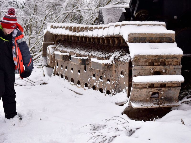 Winter Snow Cold Temperature Frozen Outdoors Warm Clothing Happiness Snowing Building Exterior One Person Ice Nature One Woman Only Day Adults Only People Adult Ice Skate Logging Equipment Logging Equipment Tracks Traction Perspective Outside Photography