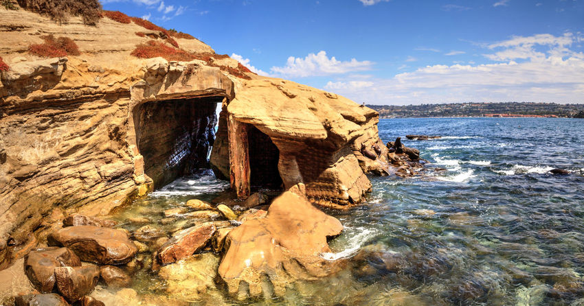 Coastal caves at La Jolla Cove in Southern California in summer on a sunny day California Coastline Ocean View USA United States Beauty In Nature Cave Coast Day La Jolla La Jolla Cove Landscape Nature No People Ocean Outdoors Rock - Object Rocks Scenics Sea Sky Sunlight Tranquility Water