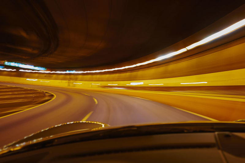 Blurred Motion Of Illuminated Lights In Tunnel