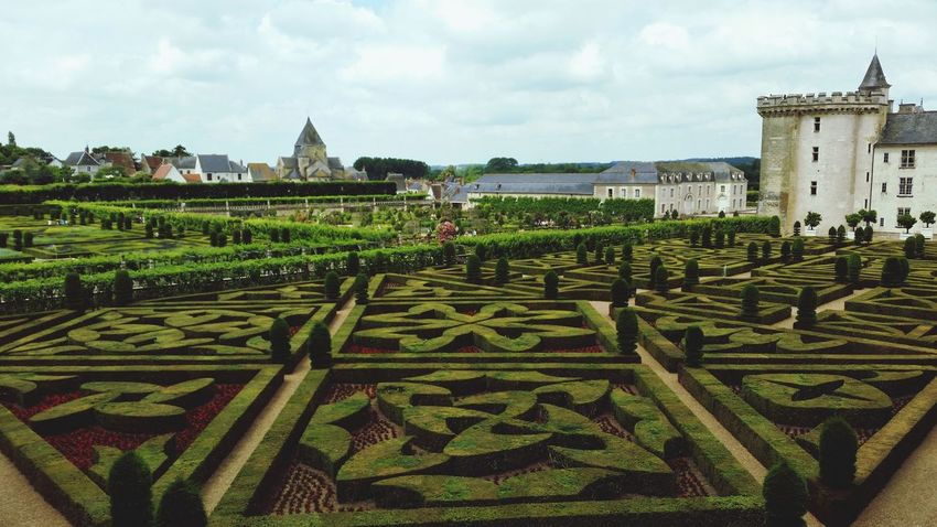 Cloud - Sky Architecture Agriculture Outdoors History Growth No People Plant Day Building Exterior Sky Nature Freshness High Angle View Chateau De Villandry Villandry Castle Villandry Villandry Chateau Villandry Gardens Vacations Travel Destinations Beauty In Nature Field Green Color Pattern
