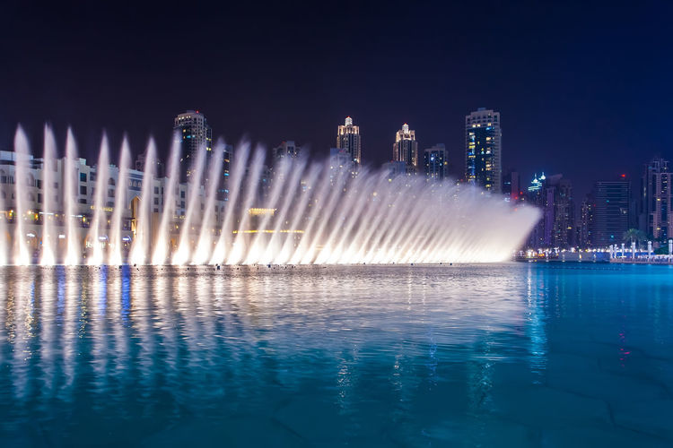 Marina Dubai Water Architecture Waterfront Night Illuminated Built Structure Motion Building Exterior Nature Sky Fountain City Reflection No People Long Exposure Sea Spraying Clear Sky Outdoors Office Building Exterior Skyscraper Luxury Cityscape Swimming Pool