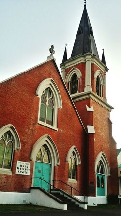 Urbanphotography Churches Cathedral Architecture Pure Blue Church Brick Summer Steeple Stained Glass Rustic Rust Color Bricks Brick Building Sky Religion Religious Architecture Religion And Beliefs Palmerston North Nz Day City Built Structure Personality  Character Protection The City Light