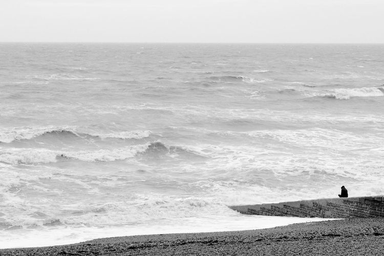 Solitude Black & White Adult Beach Beauty In Nature Blackandwhite Day Horizon Over Water Men Nature One Man Only One Person Outdoors Scenics Sea Solitude Tranquil Scene Water Wave