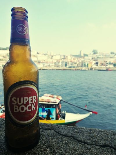 Super Bock Rabelo Rabelo Boat Rio Douro Rio Douro Portugal Douro  Douroriver Douro River Portugal Water Drink Alcohol Bottle Text Condensation Close-up Food And Drink Sky Beer Bottle Beer - Alcohol