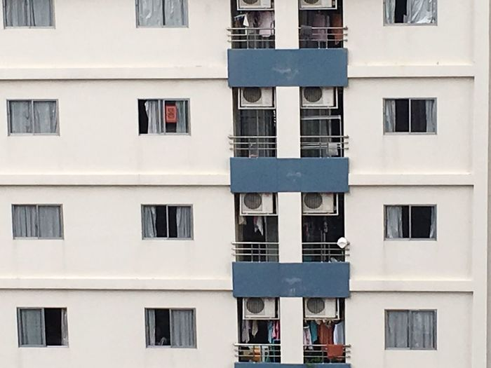EyeEm Selects The elevation of middle class of Apartment. Architecture Window Building Exterior Built Structure Residential Building Day Apartment Outdoors City Full Frame No People Beside Elevation Wall - Building Feature Terrace White Color Back View