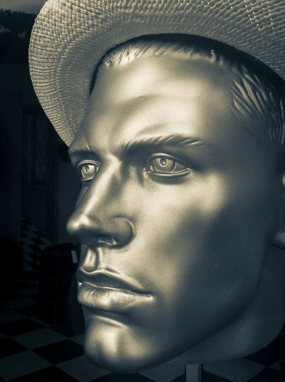 Close-up of head of male mannequin wearing a hat Close-up Face Fashion Hanging Out Hat Headshot Lifestyles Male Mannequin Portrait Shiny Silvery Window Display