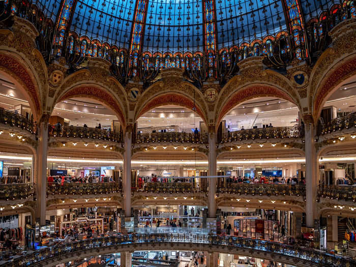Kaufhaus Lafayette in Paris France Paris ❤ Paris, France  Tower Lafayette Department Store Architecture Architecture_collection Tranquility Tranquil Scene People Fashion Luxxxs Illuminated Carousel Multi Colored Ceiling Arts Culture And Entertainment Close-up Architecture Architecture And Art Architectural Feature Interior Architectural Design Amusement Park Ride Arched Skylight Stained Glass Architectural Detail Hanging Light