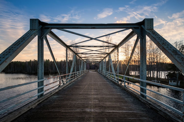 Scenic landscape with old metal bridge and road at autumn evening in Finland Bridge Connection Built Structure Architecture Sky Nature Cloud - Sky No People Outdoors Finland Sunset Sunrise Sun Beams Sun Rays Metal History Historic Old Vintage Landscape Nature Lake Water Cottage Autumn