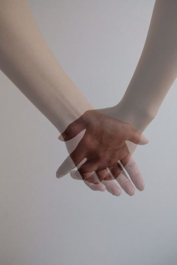 Human Hand Hand Human Body Part Indoors  One Person Adult Women Body Part Real People Studio Shot Close-up Lifestyles Finger Human Finger Wall - Building Feature Positive Emotion Gray Background Gray Touching Human Limb