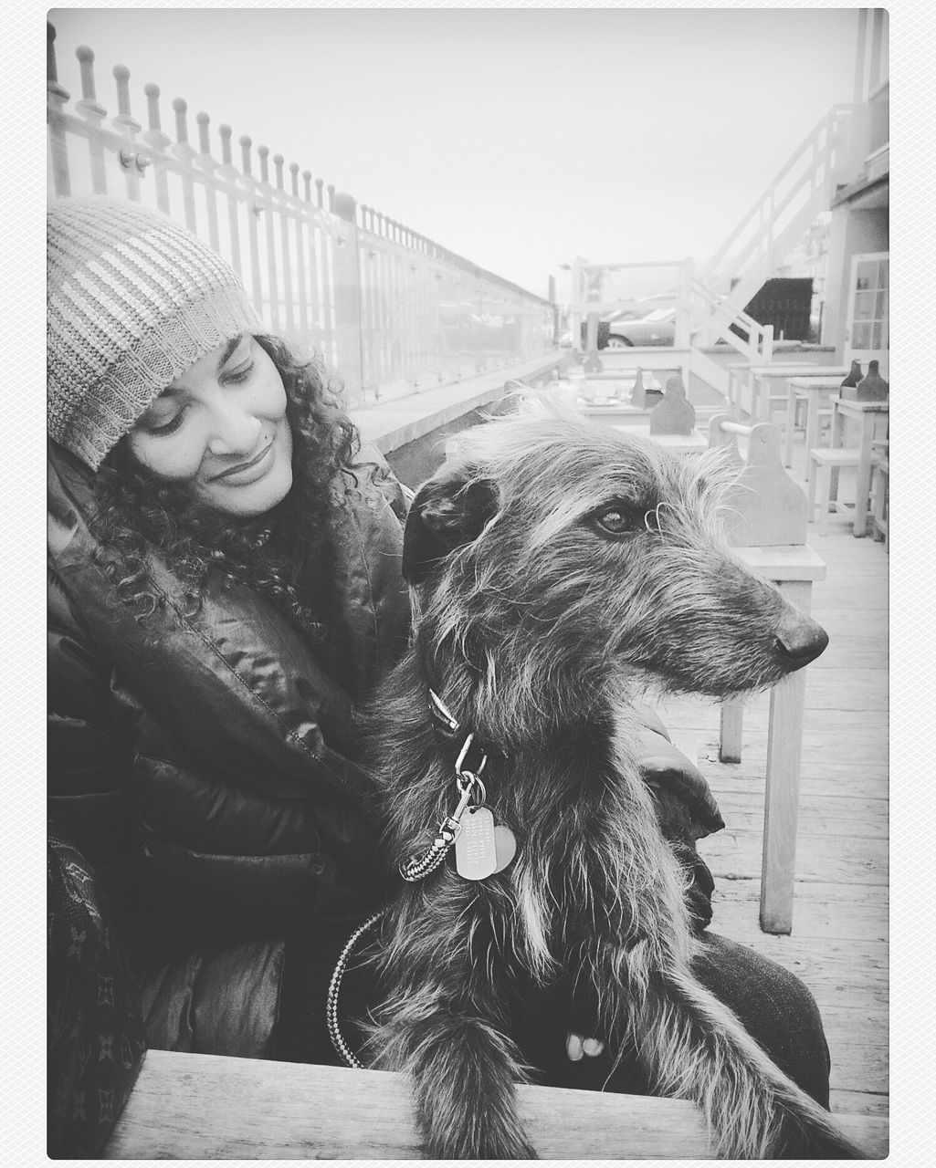 pets, dog, one person, real people, young women, young adult, leisure activity, domestic animals, day, one animal, animal themes, warm clothing, outdoors, mammal, sitting, happiness, beautiful woman, adult, people