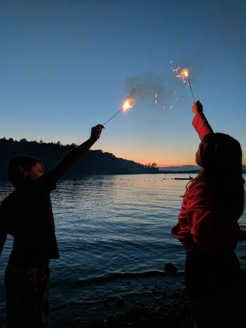 Sparkle in the night Brother And Sister ♥ Lake Life Beautiful ♥ Independenceday The Small Things In Life Children Having Fun In The Summertime Kidsbeingawesome Children Playing Family Time Sparkler 💖 Sommergefühle EyeEm Selects Lost In The Landscape