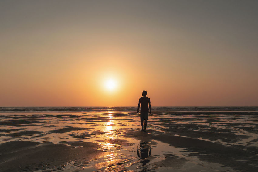 Beach Beauty In Nature Full Length Horizon Horizon Over Water Land Leisure Activity Lifestyles One Person Orange Color Real People Scenics - Nature Sea Silhouette Sky Standing Sun Sunset Tranquility Water My Best Travel Photo
