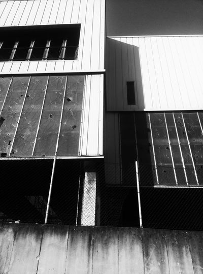 City EyeEm Gallery Blackandwhite Urban Geometry Photography EyeEm Best Shots Urbanphotography Walking Around The City  Building Exterior Building Story Architecture Architecture_collection Abandoned Buildings Historical Building Architecture Building Exterior Built Structure Focus On Shadow Metal Grate Shadow