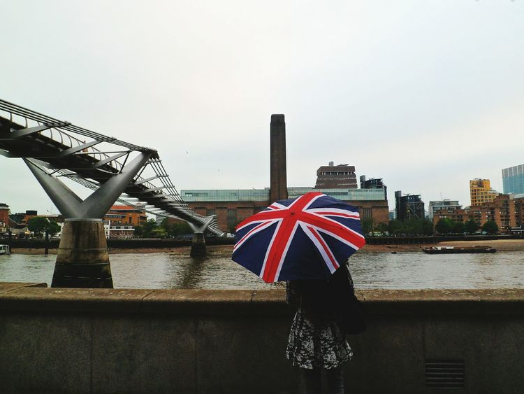 Tate Modern, Millenium Bridge and the woman with the Union Jack umbrella Famous Place Standing On The Move Woman British Culture Union Jack Umbrella Adults Only Outdoors People International Landmark Capital Cities  Travel Destinations Bridge - Man Made Structure Built Structure Day Low Angle View London Tourism Incidental People Connection Travel Architecture Millenium Bridge Water
