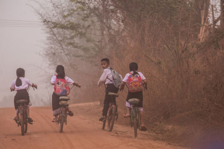 Group of people riding bicycle