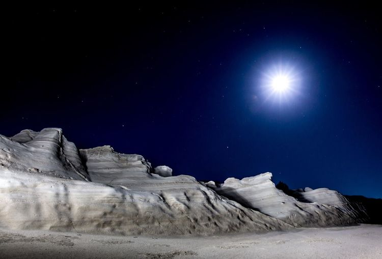 Low Angle View Of Snow Against Sky At Night