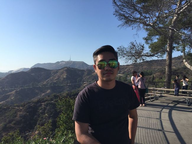 EyeEm Selects Sunglasses Real People Leisure Activity Lifestyles Mountain Eyeem Philippines Hollywood Sign Casual Clothing Day Clear Sky Tree One Person Standing Sunlight Nature Young Adult Sky People