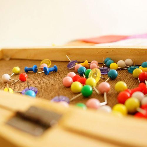 Close-up of multi colored thumbtacks