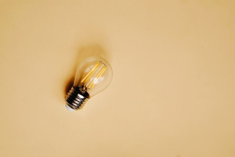 Close-up of light bulb on wall