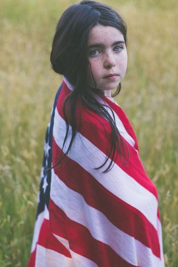 Red Patriotism Portrait Real People One Person Field Flag Looking At Camera Day Outdoors Young Adult Nature People