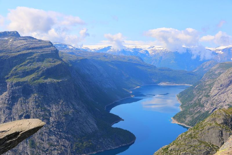 Trolltunga Water Beauty In Nature Scenics - Nature Mountain Sky Tranquil Scene Cloud - Sky Tranquility Day Nature No People Mountain Range Lake Idyllic Non-urban Scene High Angle View Environment Outdoors