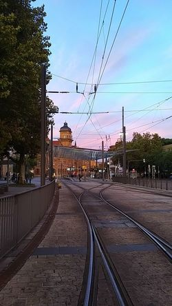 Cable Railroad Track Rail Transportation Public Transportation Outdoors Electricity  Sky Day Sunset Purple Background No People City Train Station Evening Glow